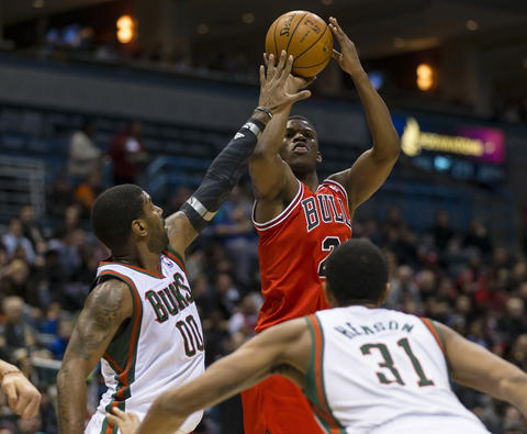 Jimmy Butler shoots against the Bucks' O.J. Mayo during the first quarter.
