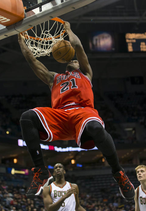 Jimmy Butler dunks during the second quarter against the Bucks.