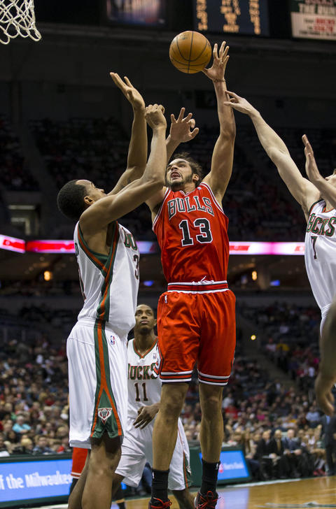 Joakim Noah shoots against the Bucks' John Henson during the second quarter.