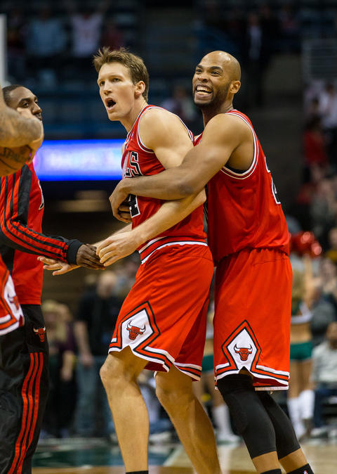Mike Dunleavy is congratulated by Taj Gibson after he hit the game-winning shot against the Bucks.