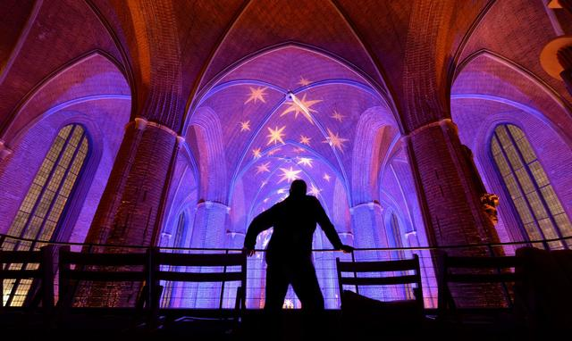 The ceiling of the Marktkirche church in Hanover, central Germany, is illuminated during a festive Christmas light installation on December 9, 2013. The illumination is presented to visitors from December 2 to 18, 2013.