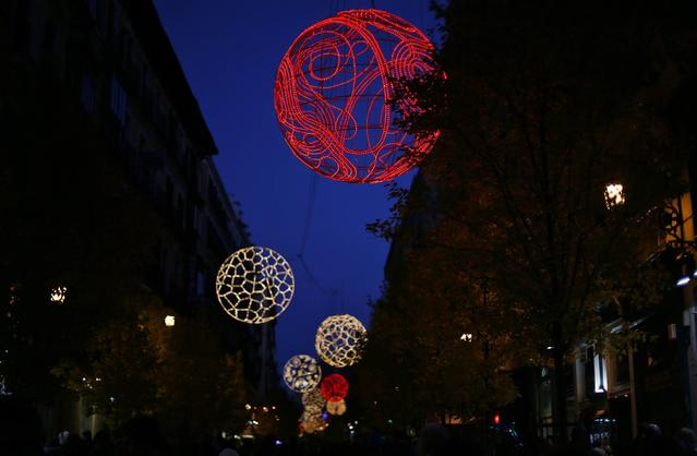 Christmas lights illuminate Arenal street in Madrid December 8, 2013.