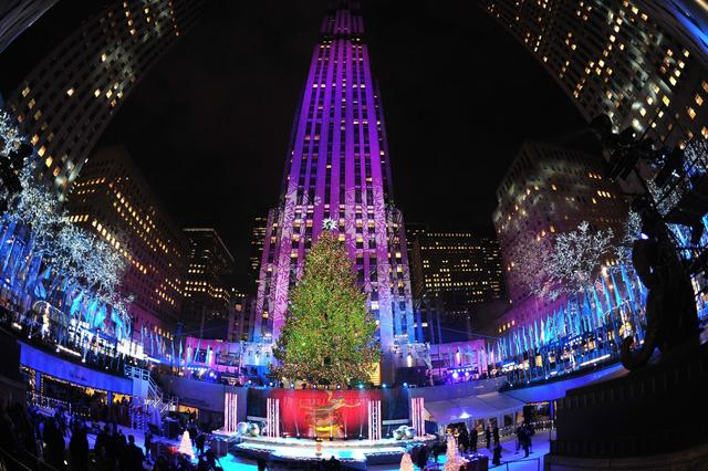 The Rockefeller Center Christmas Tree is lit December 4, 2013 in New York as seen in this long exposure zoom.