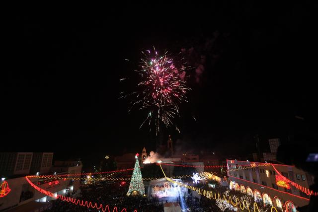Fireworks light up the sky above Christmas decorations and a Christmas tree in Bethlehem's Manger Square, outside the Church of the Nativity, believed to be the birthplace of Jesus Christ as preparations for Christmas celebrations get underway on November 30, 2013.