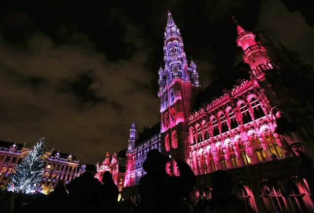 A light show is projected onto Brussels' Town Hall (R) as part of Christmas events at the Grand-Place in Brussels November 29, 2013.