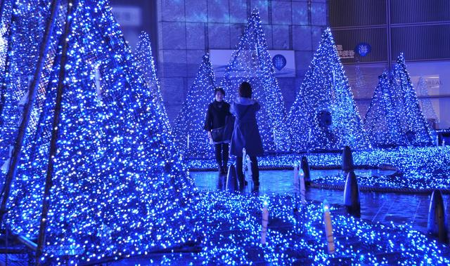 People enjoy Christmas illumination with LED lights that changes into seven colors in Tokyo's Shiodome on Nov. 26, 2012. The Christmas illumination will be displayed until Dec. 25.