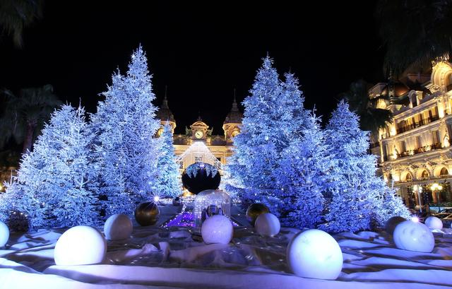Christmas lights and decorations are seen in front Monte-Carlo's casino late on December 8, 2012 in Monaco.