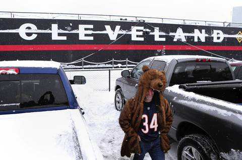 CHRIS SWEDA: While hunting for features of people tailgating, I discovered a lone fan dressed in a Bear outfit hours before the game against the Browns. I was obviously drawn to a ship beside the parking lot that gives a hint as to what city the Bears were visiting.