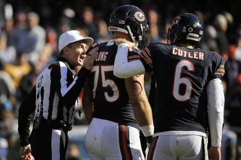 ANTHONY SOUFFLE: During a timeout in the first quarter Chicago Bears offensive guard Kyle Long shared his displeasure with some early calls with an official. After a brief chat Long got the double shoulder pat from the official and quarterback Jay Cutler. It's nice to know that even huge football players sometimes just need a reassuring pat on the back.