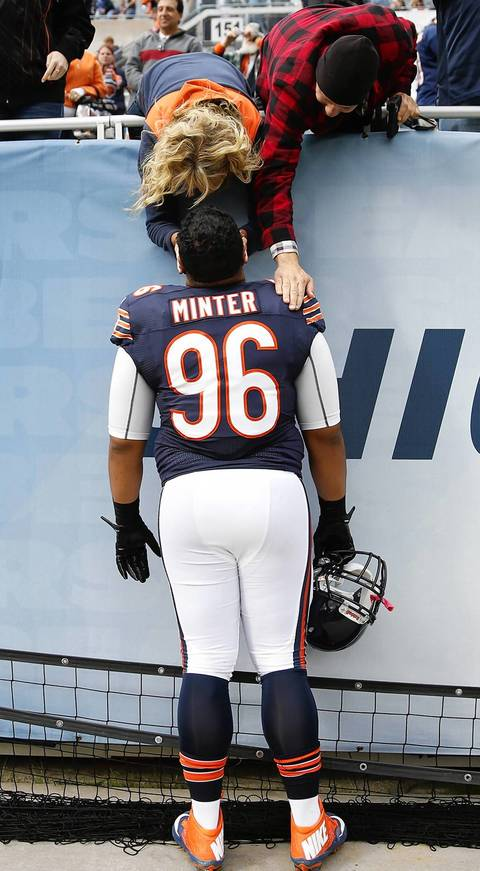 Scott Strazzante: NFL players are tough guys, but, in this image, Bears' 300 lb. rookie Zach Minter looks almost childlike as he is being consoled in the north end zone after the loss to the Saints. I love photos away from the action that give a glimpse of the human side of athletes.
