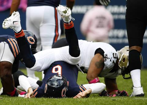 Jose M. Osorio: I like this photograph of Chicago Bears quarterback Jay Cutler (6) being tossed down onto the ground after he throws the ball. It was one of those days where Cutler was not only sacked a lot, but also hit following the throw and tossed to the ground. His body language and the framing of the photograph, after a much needed crop, is what I liked about this play even though it is not a peak action photo. It's a more subtle image.