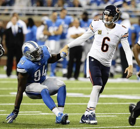 NUCCIO DINUZZO: Another unusual moment from a game where the quarterback finds himself helping a 270 lbs. man, whose job is to tear him apart. Bears quarterback Jay Cutler had a tough day and this happened toward the end of the game. It was a nice gesture from Cutler giving a hand to Lions defensive end Ezekiel Ansah.