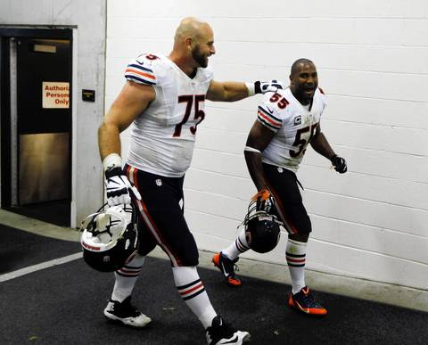 BRIAN CASSELLA: One of the advantages of shooting on the road is the variety of stadiums and shooting possibilities. At Soldier Field, photographers usually can't shoot in the tunnel as players leave the field, so I took advantage of that position as the Bears came off celebrating. Jake Long grabbed Lance Briggs as the