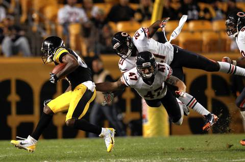 SCOTT STRAZZANTE: My second favorite image of the game was a play by Chicago Bears' defenders Chris Conte and Major Wright. The pair of safeties teamed up to stop Steelers' Antonio Brown during the crucial fourth quarter. I am a big fan of images of people in the air and although I would have preferred to have Wright¿s entire body in the frame, I was pleased with this photo.