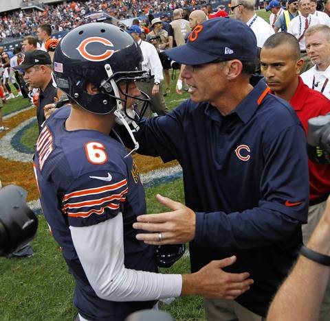 BRIAN CASSELLA: We all wanted to make interesting images of Marc Trestman, but the new head coach isn't any more active or demonstrative on the sideline than Lovie Smith. After the game many photographers followed him for the handshake with the Bengals head coach, and on his way off the field Trestman stopped to greet his quarterback. In the crowd I was fortunate to be able to lift my camera a bit and see them congratulating each other on their first win together.