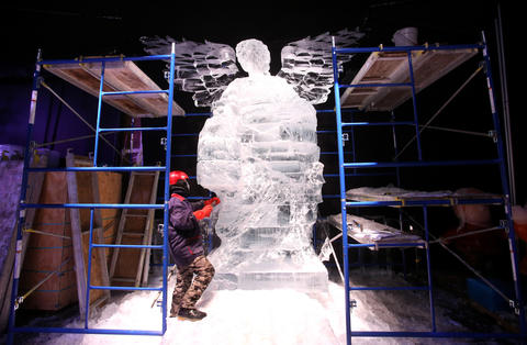 "An Ice sculptor from Harbin, China, works in 9-degree temperatures, carving the Nativity angel, while creating scenes that will be displayed during the annual ICE! exhibition at the Gaylord Palms Resort in Kissimmee, Tuesday, Oct. 29, 2013. A team of 40 Chinese artisans spend a month creating the award-winning attraction, which opens Nov. 23 and runs through January 5, 2014. New for this year's ICE!: ""Artisans in Action"" Ð a live ice-carving zone, where sculptors demonstrate their unique skills and guests get an up-close view of ice masterpieces being created. (Joe Burbank/Orlando Sentinel) B583297061Z.1"