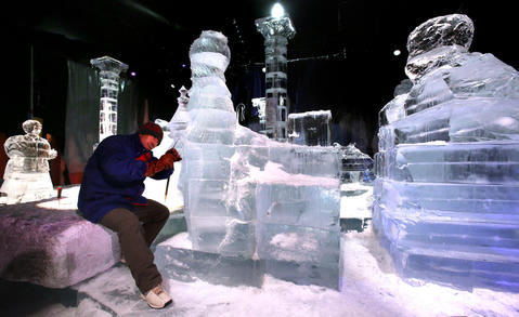 "Ice sculptors from Harbin, China, work in 9-degree temperatures while creating scenes that will be displayed during the annual ICE! exhibition at the Gaylord Palms Resort in Kissimmee, Tuesday, Oct. 29, 2013. A team of 40 Chinese artisans spend a month creating the award-winning attraction, which opens Nov. 23 and runs through January 5, 2014. New for this year's ICE!: ""Artisans in Action"" ¿ a live ice-carving zone, where sculptors demonstrate their unique skills and guests get an up-close view of ice masterpieces being created. (Joe Burbank/Orlando Sentinel) B583297061Z.1"