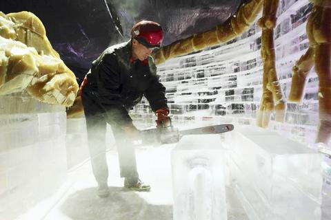 Chinese artisans work on the Ice! attraction at Gaylord Palms, on Monday, November 7, 2011.
