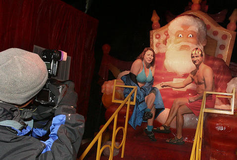 "Debra Bennett and John Endries get their picture made with the frozen Santa. They came from Tampa . On Friday, Gaylord Palms Resort 's ICE! opened an hour early to welcome guests as they become official members of the Orlando Polar Bear Club. Afterwards, participants will be recognized at a ""warm-up"" coffee and cocoa reception, during an official induction into the club."