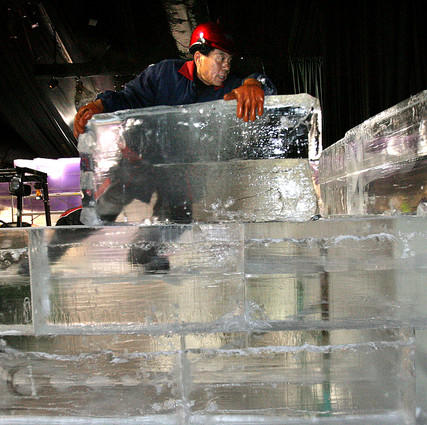 Li Hui Xian, an artisan from Harbin, China, slides blocks of ice while building a wall as he and a team 40 work on creating the 2007 edition of Ice!, the annual holiday ice attraction at the Gayord Palms Resort in Kissimmee on Tuesday.