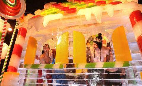 "Polar bear guests play in a house made of ice to look like candy. On Friday, Gaylord Palms Resort 's ICE! opened an hour early to welcome guests as they become official members of the Orlando Polar Bear Club. Afterwards, participants will be recognized at a ""warm-up"" coffee and cocoa reception, during an official induction into the club. Guests were invited to tour the 9 degree ice displays clad only in bathing suits to debut their Polar Bear club. The carved ice display has become a regular seasonal feature at Gaylord Palms and last until January 4."