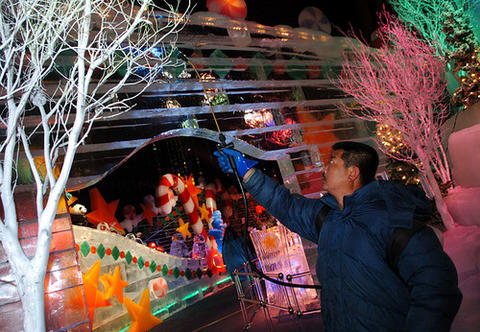 Chinese artisan Shuli Huo sprays chilled water on trees to create a coating of ice Saturday, Nov. 25, 2006.