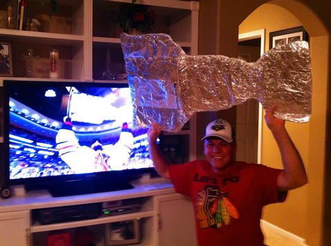 "Game 6 just ended. Hawks win 3-2. Jack Zwit hoisting ""Da Cup"" at home. Yeah Baby!"