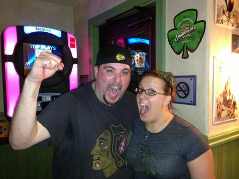 My wife (Silvia Diz) and I (Alex Diz) right after the clock hit 0 and the Blackhawks once again took the cup.