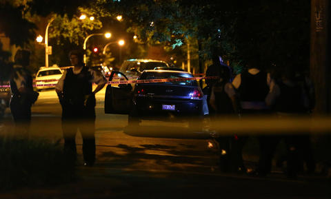 Chicago police investigate the scene where two people were shot, including one who died, in the 200 block of South Keeler Avenue in Chicago.