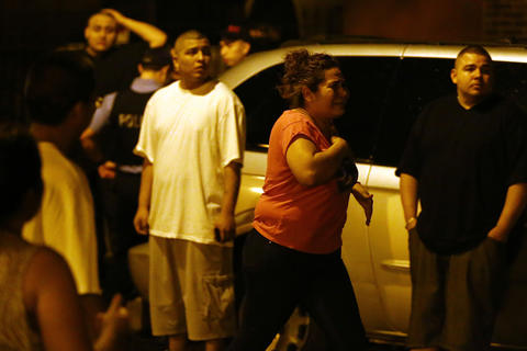 A woman who identified herself as the mother of a man who was killed arrives at the scene where three people were shot, including the one who died, in the 2500 block of South Ridgeway Avenue in Chicago.