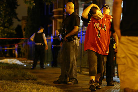 A man who identified himself as the cousin of a man who was killed shows his emotion at the scene where three people were shot, including the one who died, in the 2500 block of South Ridgeway Avenue in Chicago.