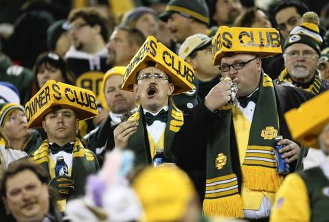 JOHN J. KIM: A trio of Green Bay Packers fans wear matching garb during a game against the Chicago Bears at Lambeau Field Monday, Nov. 4, 2013, in Green Bay. Oftentimes, a photograph is graphically appealing when there are three elements. I like the expression on these gentleman, in addition to their attire.