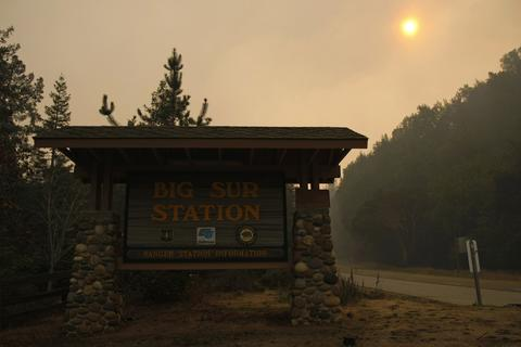 Heavy smoke from wildfires engulfs the Big Sur Station, in Big Sur, California, December 17, 2013. The wildfire that erupted in a scenic stretch of California's central coastline late Sunday night has destroyed at least 15 homes and forced many residents to evacuate, county and fire officials said. The ranger station is the headquarters for the firefighting operations.