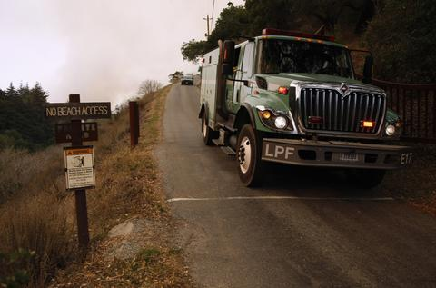 A fire truck leaves the Pfeiffer Ridge region during a wildfire in Big Sur, California, December 17, 2013. The wildfire that erupted in a scenic stretch of California's central coastline late Sunday night has destroyed at least 15 homes and forced many residents to evacuate, county and fire officials said.