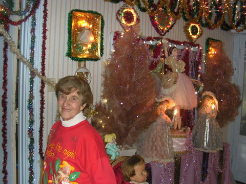 Rita Giancola of New Britain in one of many rooms in her home at 61 Lexington Street she has decorated for Christmas in 2009.