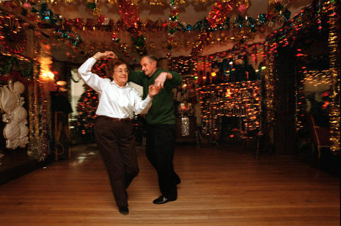 "Gyslenne ""Jessie"" Ricci, of West Hartford, dances with Franklin Pratt, of Bristol, during a ballroom dance lesson at the studio of Rita Giancola. Giancola, who has been teaching ballroom dance lessons since the 1950s, is well known for the elaborate Christmas decorations she adorns her entire house with - inside and out - each year."