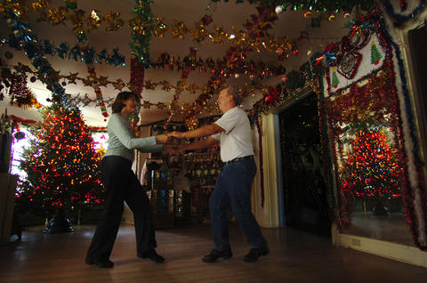 Elizabeth and Stephen Rosa, of the Terryville section of Bristol, practice swing dancing during a private dance class at the ballroom dance studio of Rita Giancola surrounded by Christmas decorations.