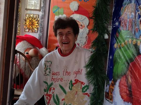 Rita Giancola welcomes visitors to Christmas House in New Britain.
