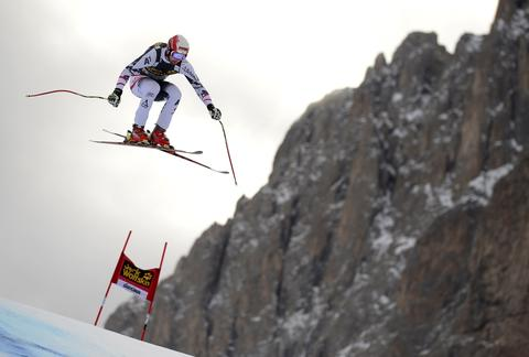 Austria's Joachim Puchner competes during the second training session of the FIS Alpine World Cup Men's Downhill on December 19, 2013 in Val Gardena.