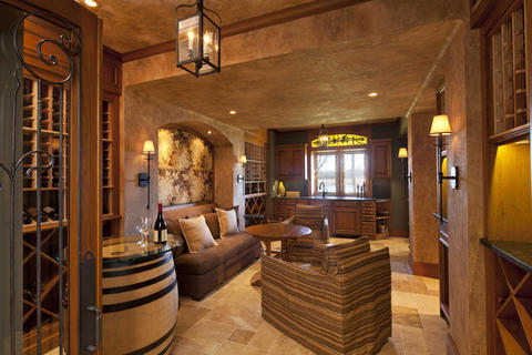 """Man caves"" are growing in popularity as more men are working from home. The toys are getting bigger and more sophisticated. ""We're going to see more upscale man caves, media rooms full of gadgets, and outrageous wine rooms,"" says Victoria Jenkins of The Sofa Store in Towson. ""That's the most fun."" Shown: A wine room designed by Pyramid Builders."