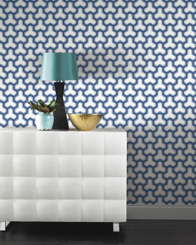 "Steve Appel, of Nouveau Contemporary, is using graphic wallpapers quite a bit in settings, especially patterns that are an update to the traditional Greek key. ""Vintage style hexagon papers especially are very hot in decorating this season,"" he says. Shown: Antonina Vella's Contempo wallpaper collection's Rina pattern in cobalt blue from York Wallcoverings."