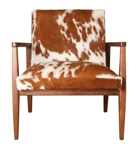 "Animal themes will play a big role in home decor, just as in fashion. ""Animal patterns will never go away,"" says designer Victoria Jenkins of The Sofa Store in Towson. ""[At High Point] they were putting it everywhere -- ottomans, chairs, area rugs. It's splashed on it. It is an accent piece. It pops."" Shown: Retro Brown Hide Chair from Arhaus Furniture"