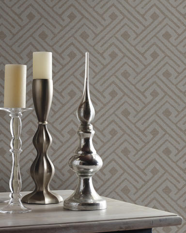 """Whether it be an accent wall, a feature wall or wrapping the entire room, Appel says, ""Circles, hexagons and really any tightly formed shapes in wallpaper are getting a lot of attention. We especially like using them in powder rooms and kitchens."" Shown: Carey Lind's Jewel Box wallpaper collection's Insignia pattern in silver on mink, from York Wallcoverings."