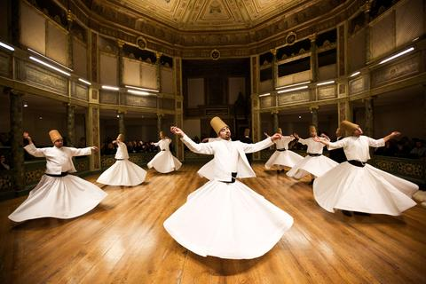 Whirling dervishes perform at the Galata Mevlevihane (The Lodge of the Dervishes) in Istanbul on December 18, 2013. The dervishes are adepts of Sufism, a mystical form of Islam that preaches tolerance and a search for understanding. Those who whirl, like planets around the sun, turn dance into a form of prayer.
