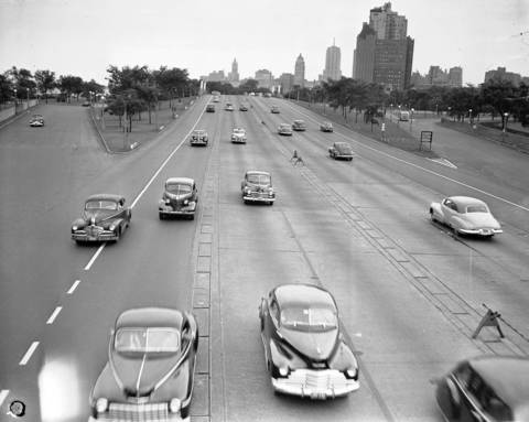 Automobiles on Lake Shore Drive pour back into the city after a holiday weekend on July 6, 1947. This photo was taken at 7:30pm from the North Avenue bridge. From the 1940s to the '70s, a section north of North Avenue featured a unique, though problem-plagued, system of curb-high lane barriers that could be raised or lowered to provide six lanes in the direction of rush-hour traffic instead of the standard four lanes in each direction.