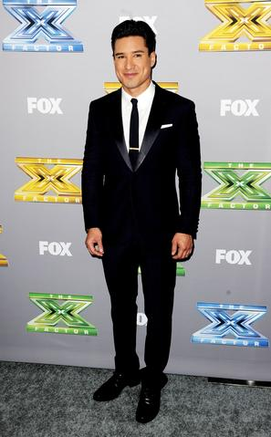"TV personality Mario Lopez poses at Fox's ""The X Factor"" Season Finale at CBS Television City on December 19, 2013 in Los Angeles, California."