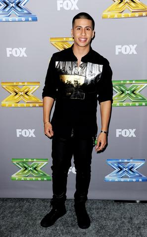 "Singer Carlito Olivero poses at Fox's ""The X Factor"" Season Finale at CBS Television City on December 19, 2013 in Los Angeles, California."