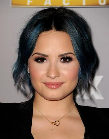 "Singer Demi Lovato poses at Fox's ""The X Factor"" Season Finale at CBS Television City on December 19, 2013 in Los Angeles, California."