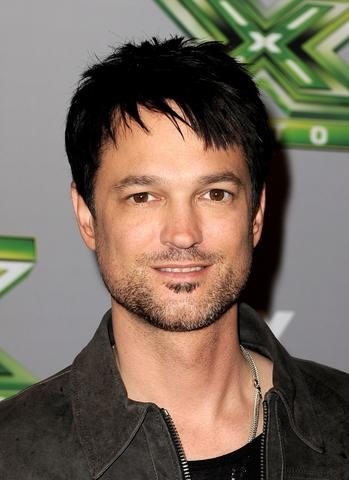"Singer Jeff Gutt poses at Fox's ""The X Factor"" Season Finale at CBS Television City on December 19, 2013 in Los Angeles, California."