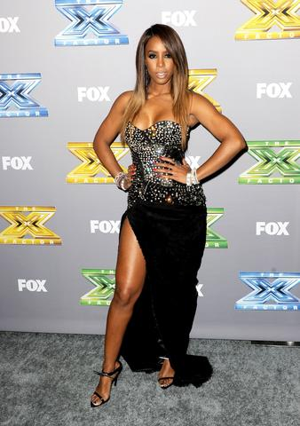"Singer Kelly Rowland poses at Fox's ""The X Factor"" Season Finale at CBS Television City on December 19, 2013 in Los Angeles, California."